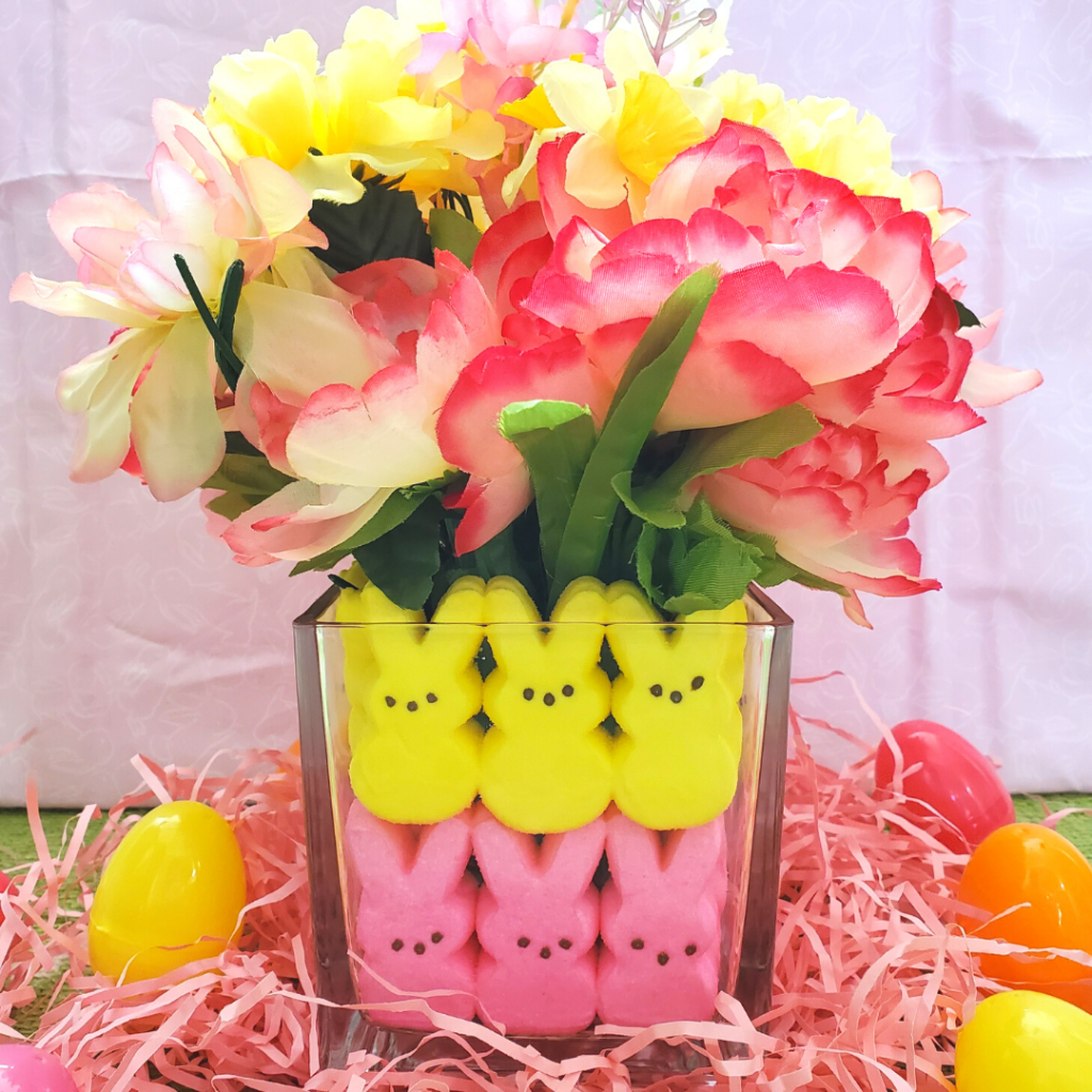 This DIY Easter Peeps Centerpiece is so quick and easy to put together and I guarantee it will brighten your spring tablescape, whether you are hosting an Easter or spring celebration or just want to add some cute DIY spring decor to your space.