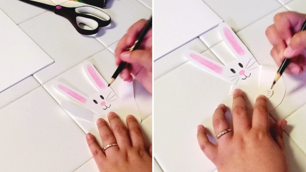 A fun and easy spring craft for families, these adorable bunnies are made out of your handprint! Here, with a black colored pencil, add whiskers on either side of the bunny's face. Then, fold down the pinky and thumb to make the bunny's arms, and with a black colored pencil, create the bunny's toes.
