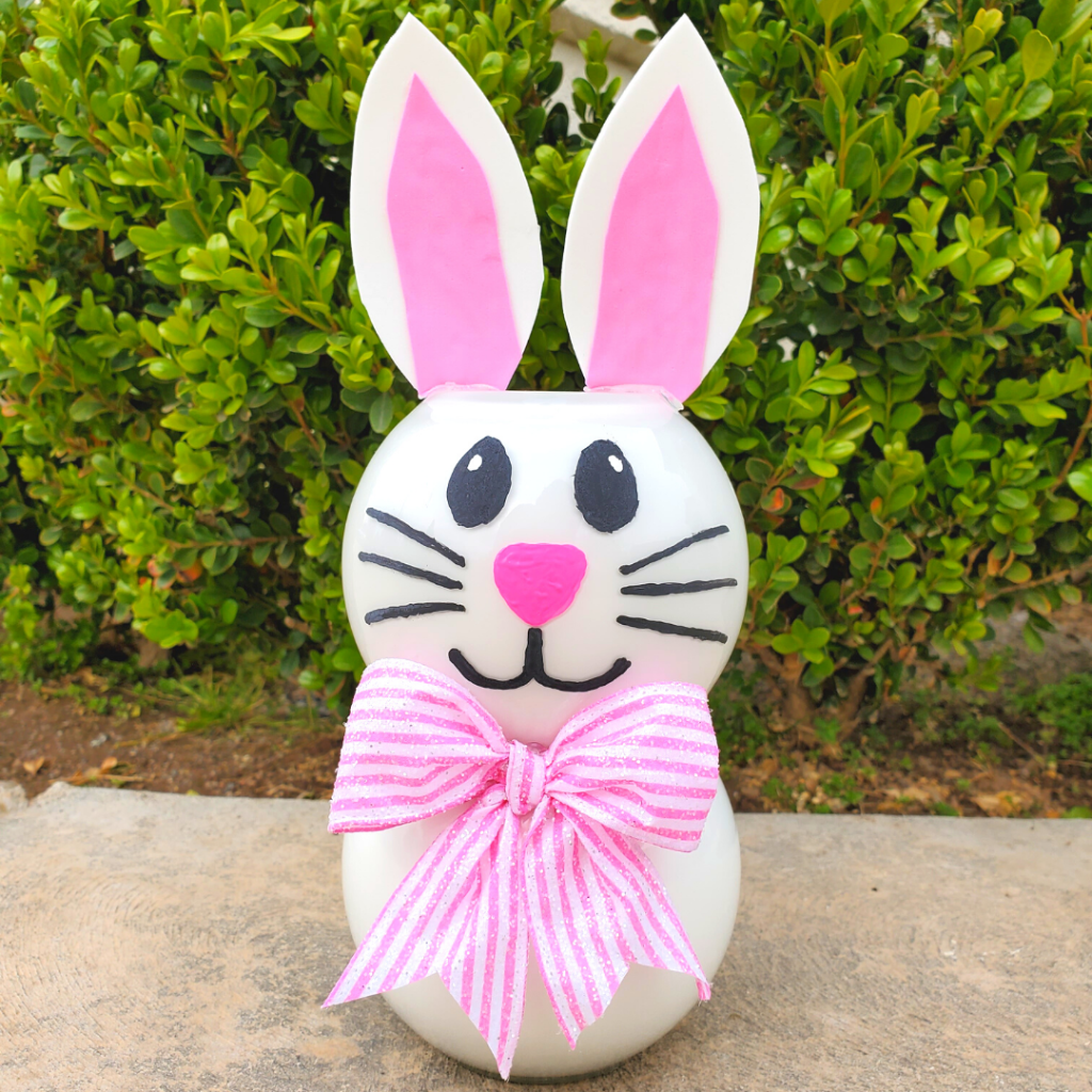 Want to make some Easter decorations to add some cute bunny decor to your home? Learn how to create this easy decorative DIY Glass Jar Easter Bunny craft using dollar store glass jars and paint for a fun Easter decor idea!