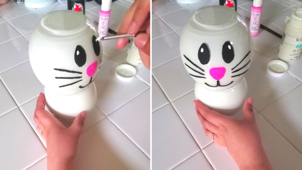 painting a line with the black paint underneath the nose and create two curved lips stemming from that line Add a single white dot to the bunny's eyes to make them look more animated.
